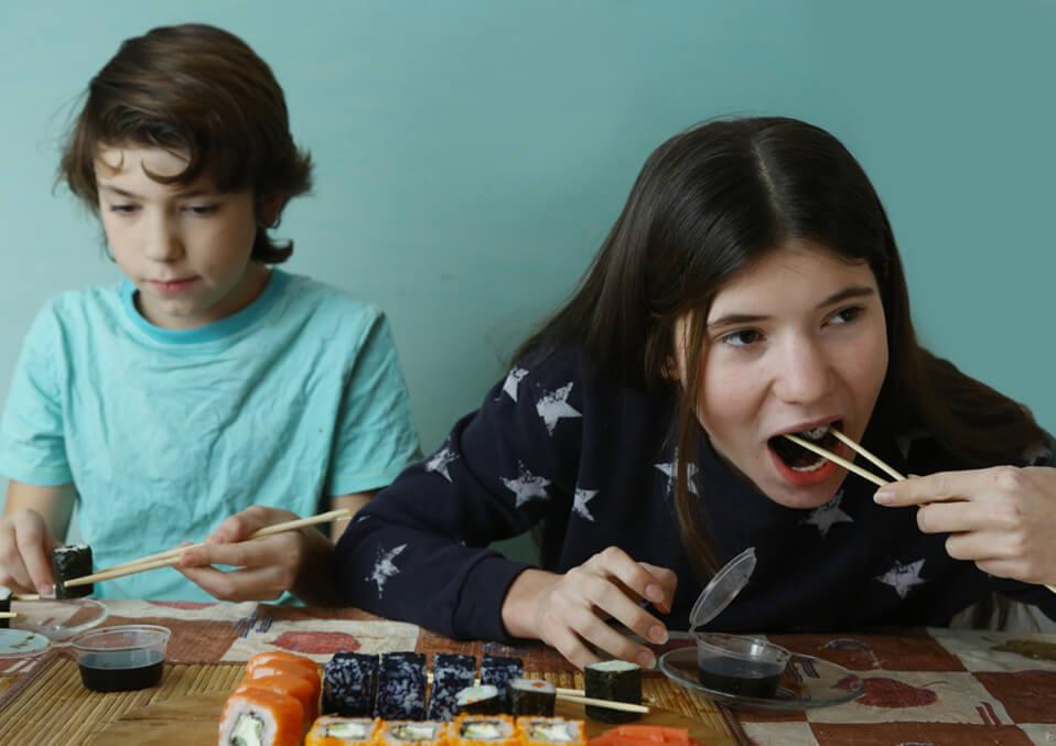 children eat sushi